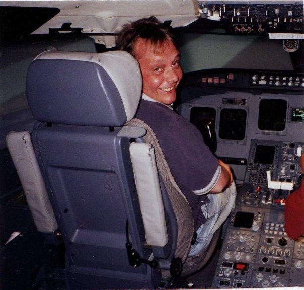 Rob in the cockpit of a CRJ700 Simulator